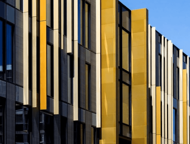 Yellow cladding panels on the walls at theUniversity of Birmingham Library
